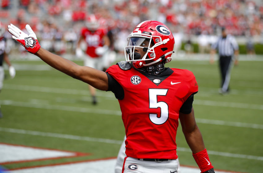 ATHENS, GA - APRIL 17: Wide receiver Adonai Mitchell #5 of the Georgia Bulldogs reacts after a touchdown during the first half of the G-Day spring game at Sanford Stadium on April 17, 2021 in Athens, Georgia. (Photo by Todd Kirkland/Getty Images)