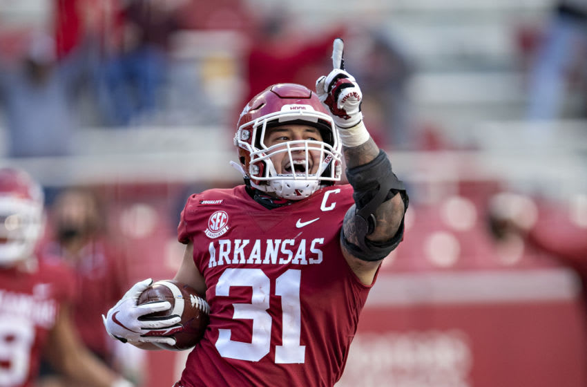 FAYETTEVILLE, AR - OCTOBER 17: Grant Morgan #31 of the Arkansas Razorbacks celebrates after returning an interception for a touchdown during a game against the Mississippi Rebels at Razorback Stadium on October 17, 2020 in Fayetteville, Arkansas. The Razorbacks defeated the Rebels 33-21. (Photo by Wesley Hitt/Getty Images)