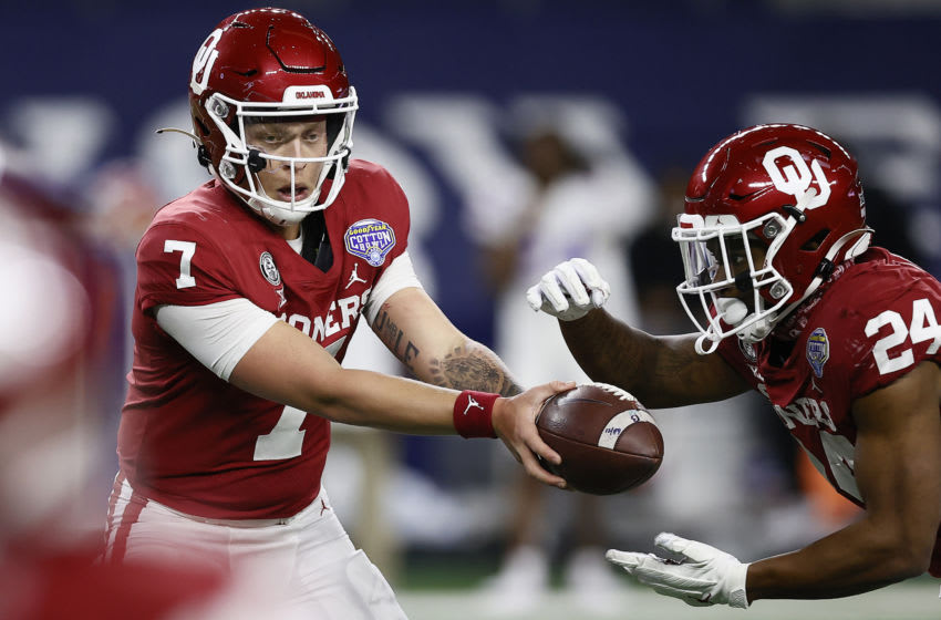 ARLINGTON, TEXAS - DECEMBER 30: Quarterback Spencer Rattler #7 hands off to running back Marcus Major #24 of the Oklahoma Sooners against the Florida Gators during the second half at AT&T Stadium on December 30, 2020 in Arlington, Texas. (Photo by Tom Pennington/Getty Images)