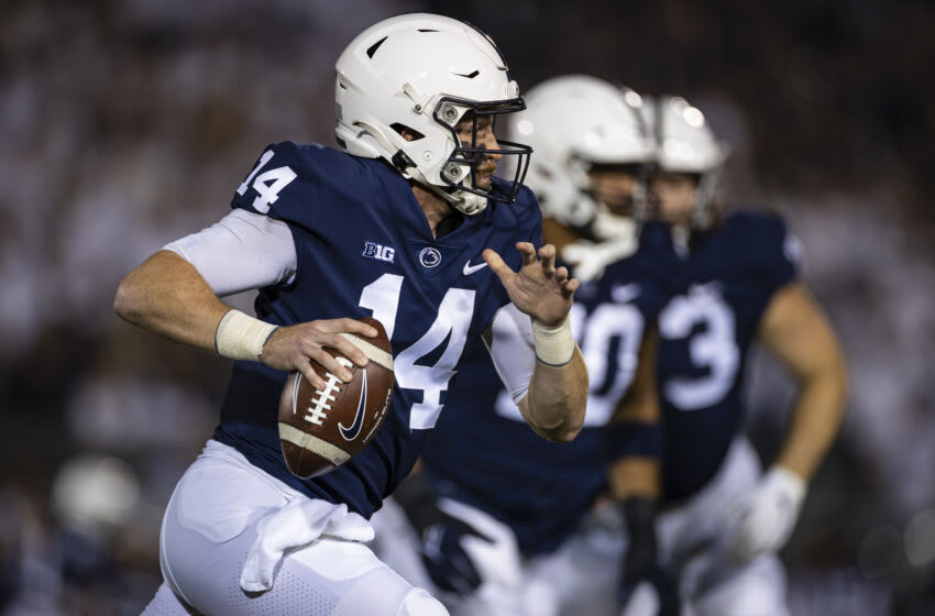 STATE COLLEGE, PA - OCTOBER 02: Sean Clifford #14 of the Penn State Nittany Lions scrambles against the Indiana Hoosiers during the first half at Beaver Stadium on October 2, 2021 in State College, Pennsylvania. (Photo by Scott Taetsch/Getty Images)