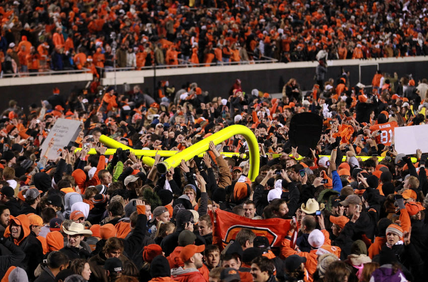 STILLWATER, OK - DECEMBER 03: Oklahoma State Cowboys fans carry the goal post after a 44-10 win against the Oklahoma Sooners at Boone Pickens Stadium on December 3, 2011 in Stillwater, Oklahoma. (Photo by Ronald Martinez/Getty Images)