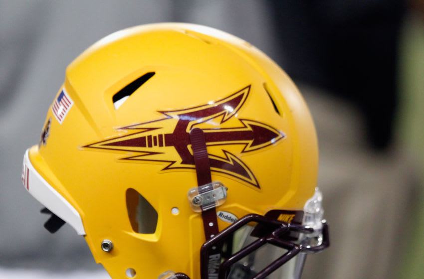 PULLMAN, WA - OCTOBER 31: An Arizona State Sun Devils football helmet hangs near the sideline during the game against the Washington State Cougars at Martin Stadium on October 31, 2013 in Pullman, Washington. (Photo by William Mancebo/Getty Images)