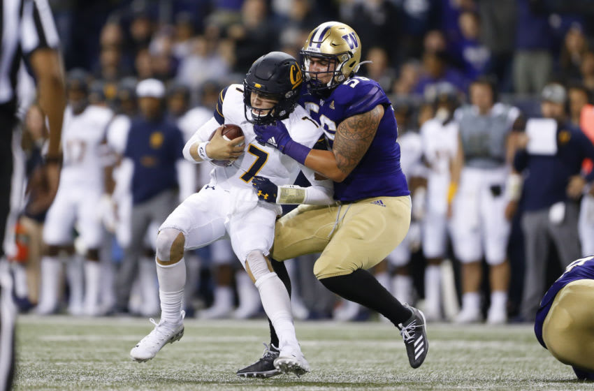 Sep 7, 2019; Seattle, WA, USA; Washington Huskies linebacker Laiatu Latu (56) sacks California Golden Bears quarterback Chase Garbers (7) in the second quarter at Husky Stadium. Mandatory Credit: Jennifer Buchanan-USA TODAY Sports