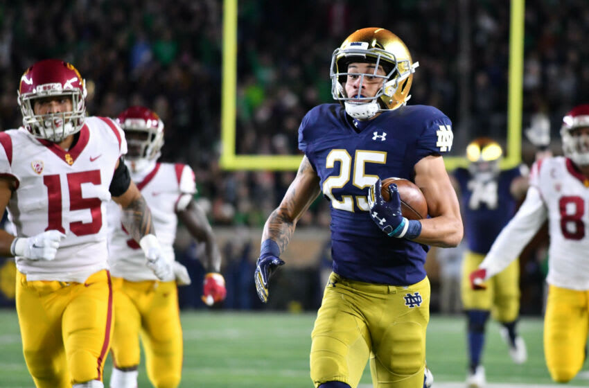 Oct 12, 2019; South Bend, IN, USA; Notre Dame Fighting Irish wide receiver Braden Lenzy (25) runs for a touchdown as USC Trojans safety Talanoa Hufanga (15) pursues in the second quarter at Notre Dame Stadium. Mandatory Credit: Matt Cashore-USA TODAY Sports
