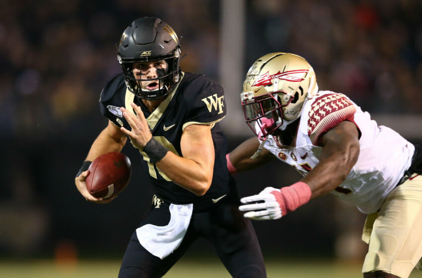 Oct 19, 2019; Winston-Salem, NC, USA; Wake Forest Demon Deacons quarterback Sam Hartman (10) carries the ball against the Florida State Seminoles in the first quarter at BB&T Field. Mandatory Credit: Jeremy Brevard-USA TODAY Sports