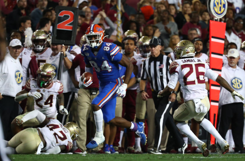Nov 30, 2019; Gainesville, FL, USA; Florida Gators tight end Kyle Pitts (84) runs with the ball against the Florida State Seminoles during the second quarter at Ben Hill Griffin Stadium. Mandatory Credit: Kim Klement-USA TODAY Sports