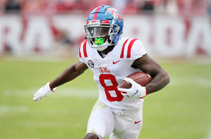 Oct 17, 2020; Fayetteville, Arkansas, USA; Ole Miss Rebels wide receiver Elijah Moore (8) runs after a catch against the Arkansas Razorbacks at Donald W. Reynolds Razorback Stadium. Arkansa won 33-21. Mandatory Credit: Nelson Chenault-USA TODAY Sports