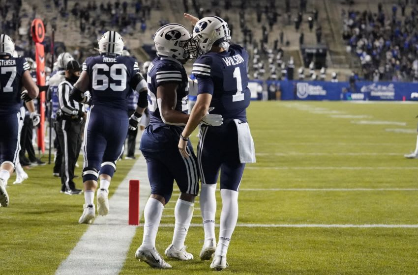 Oct 24, 2020; Provo, UT, USA; BYU quarterback Zach Wilson (1) celebrates with teammate Tyler Allgeier (25) after he scores against Texas State in the first half during an NCAA college football game Saturday, Oct. 24, 2020, in Provo, Utah. Mandatory Credit: Rick Bowmer/Pool Photo-USA TODAY NETWORK