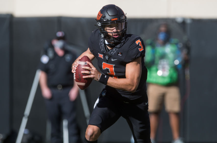 Oct 31, 2020; Stillwater, Oklahoma, USA; Oklahoma State Cowboys quarterback Spencer Sanders (3) rolls out to pass against the Texas Longhorns during the first quarter at Boone Pickens Stadium. Mandatory Credit: Brett Rojo-USA TODAY Sports