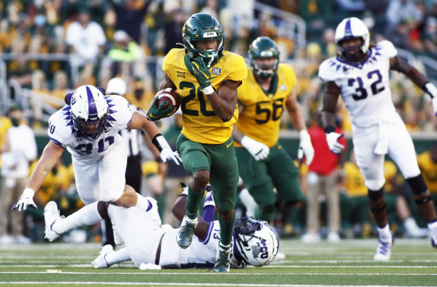 Oct 31, 2020; Waco, Texas, USA; Baylor Bears running back Craig Williams (20) carries the ball for a 35-yard touchdown run against the TCU Horned Frogs during the second half at McLane Stadium. Mandatory Credit: Raymond Carlin III-USA TODAY Sports