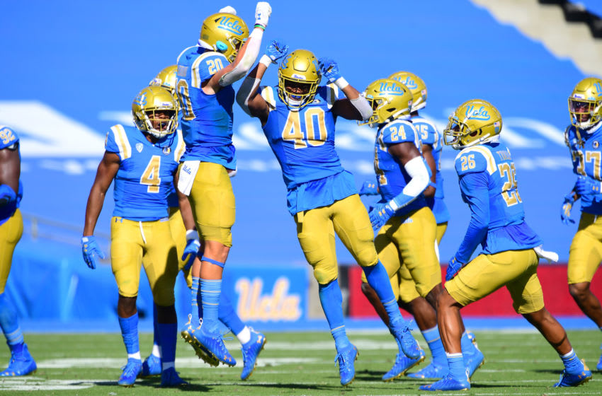 Nov 15, 2020; Pasadena, California, USA; UCLA Bruins linebacker Caleb Johnson (40) celebrates with defensive back Grady Liddell (20) after making an interception against the California Golden Bears in the first half at the Rose Bowl. Mandatory Credit: Jayne Kamin-Oncea-USA TODAY Sports