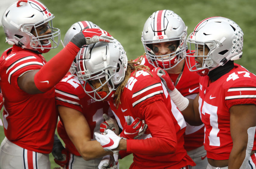 Nov 21, 2020; Columbus, Ohio, USA; Ohio State Buckeyes cornerback Shaun Wade (24) celebrates his interception return for a touchdown during the third quarter against the Indiana Hoosiers at Ohio Stadium. Mandatory Credit: Joseph Maiorana-USA TODAY Sports