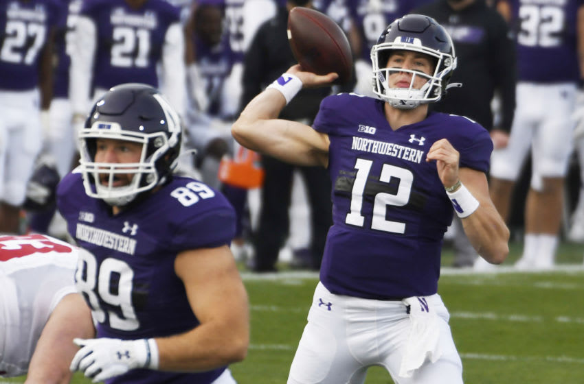 Nov 21, 2020; Evanston, Illinois, USA; Northwestern Wildcats quarterback Peyton Ramsey (12) passes the ball against the Wisconsin Badgers during the first half at Ryan Field. Mandatory Credit: David Banks-USA TODAY Sports