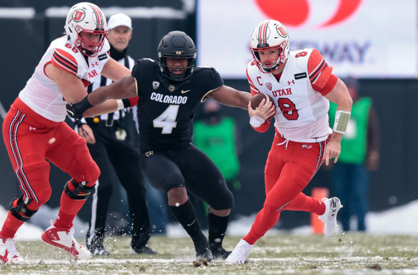 Dec 12, 2020; Boulder, Colorado, USA; Utah Utes quarterback Jake Bentley (8) runs the ball ahead of Colorado Buffaloes linebacker Jamar Montgomery (4) in the first quarter at Folsom Field. Mandatory Credit: Isaiah J. Downing-USA TODAY Sportsffd