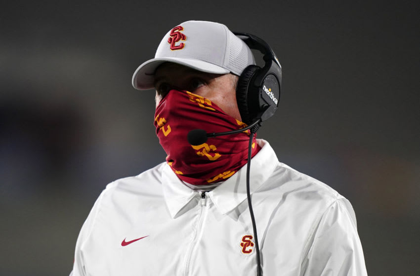 Dec 12, 2020; Pasadena, California, USA; Southern California Trojans head coach Clay Helton watches from the sidelines in the fourth quarter against the UCLA Bruins at Rose Bowl. USC defeated UCLA 43-38. Mandatory Credit: Kirby Lee-USA TODAY Sports