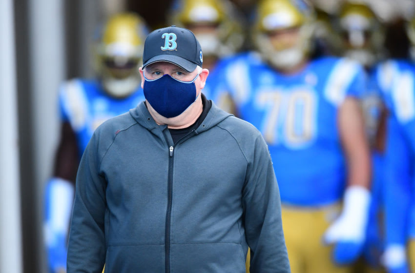 Dec 19, 2020; Pasadena, California, USA; UCLA Bruins head coach Chip Kelly leads his team on to the field for the game against the Stanford Cardinal at the Rose Bowl. Mandatory Credit: Jayne Kamin-Oncea-USA TODAY Sports
