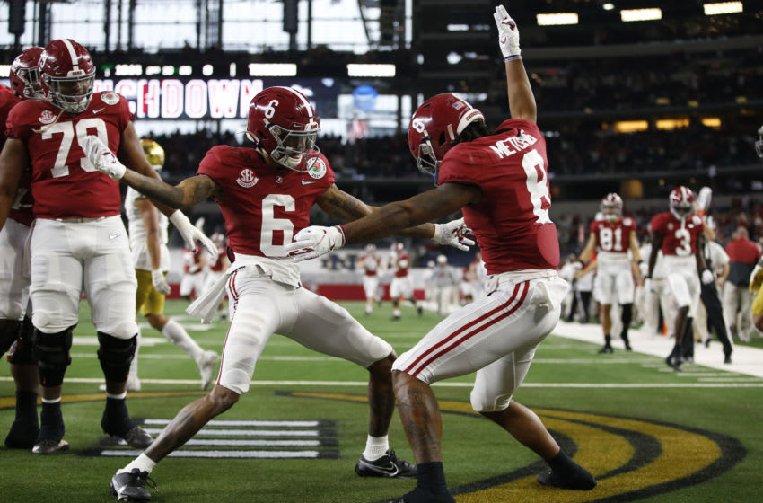 Jan 1, 2021; Arlington, TX, USA; Alabama Crimson Tide wide receiver DeVonta Smith (6) celebrates with wide receiver John Metchie III (8) after scoring a touchdown against the Notre Dame Fighting Irish in the first quarter during the Rose Bowl at AT&T Stadium. Mandatory Credit: Tim Heitman-USA TODAY Sports