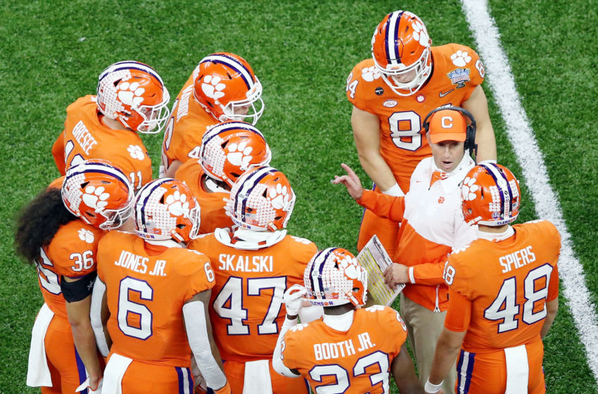 Jan 1, 2021; New Orleans, LA, USA; Clemson Tigers head coach Dabo Swinney talks to his team between plays during the first quarter against the Ohio State Buckeyes at Mercedes-Benz Superdome. Mandatory Credit: Russell Costanza-USA TODAY Sports
