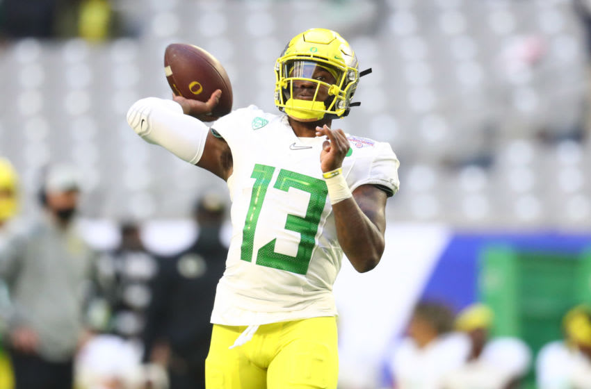 Jan 2, 2021; Glendale, AZ, USA; Oregon Ducks quarterback Anthony Brown (13) throws a pass against the Iowa State Cyclones in the first half of the Fiesta Bowl at State Farm Stadium. Mandatory Credit: Mark J. Rebilas-USA TODAY Sports