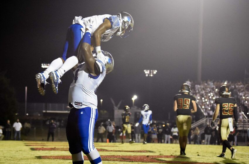 IMG Academy's Xavier Terrell (5) celebrates his touchdown against Ravenwood with Tyler Booker (54) during the second half at Ravenwood High School in Brentwood, Tenn., Friday, Sept. 25, 2020. Rhs Img 092520 An 016