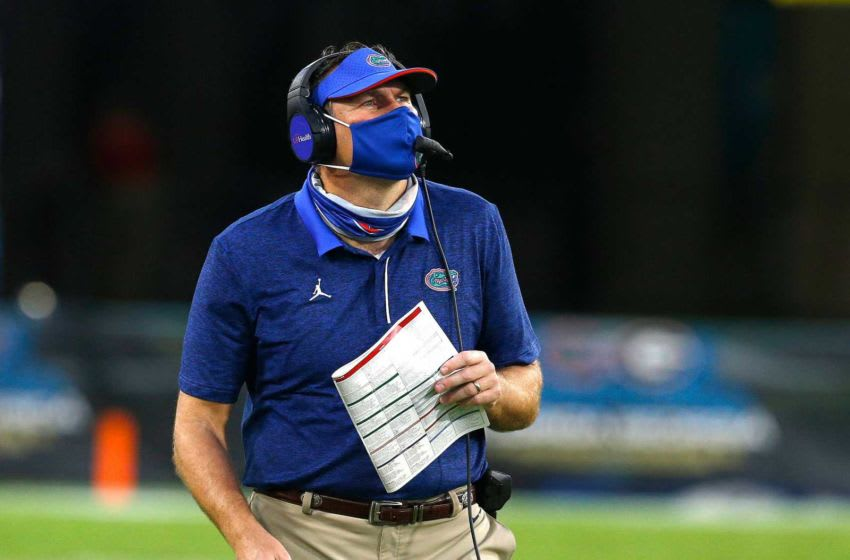 Florida head coach Dan Mullen looks up to the clock in the second half of the annual Florida Georgia rivalry game held at TIAA Bank Field in Jacksonville Fla. Nov. 7, 2020. Florida Georgia Football 59