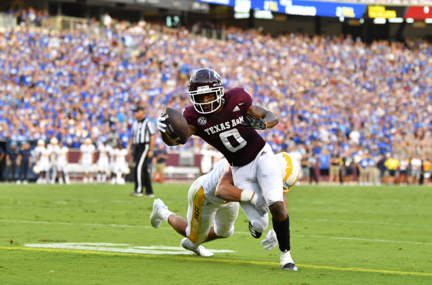 Sep 4, 2021; College Station, Texas, USA; Texas A&M Aggies wide receiver Ainias Smith (0) scores a touch down as Kent State Golden Flashes linebacker A.J. Musolino (19) defends during the first quarter at Kyle Field. Mandatory Credit: Maria Lysaker-USA TODAY Sports