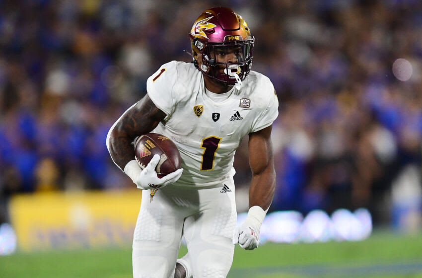 Oct 2, 2021; Pasadena, California, USA; Arizona State Sun Devils running back DeaMonte Trayanum (1) runs the ball against the UCLA Bruins during the first half at Rose Bowl. Mandatory Credit: Gary A. Vasquez-USA TODAY Sports