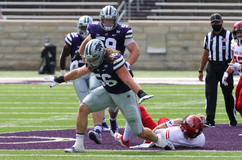 Sep 12, 2020; Manhattan, Kansas, USA; Kansas State Wildcats defensive end Wyatt Hubert (56) celebrates a sack of Arkansas State Red Wolves quarterback Logan Bonner (12) during a game at Bill Snyder Family Football Stadium. Mandatory Credit: Scott Sewell-USA TODAY Sports