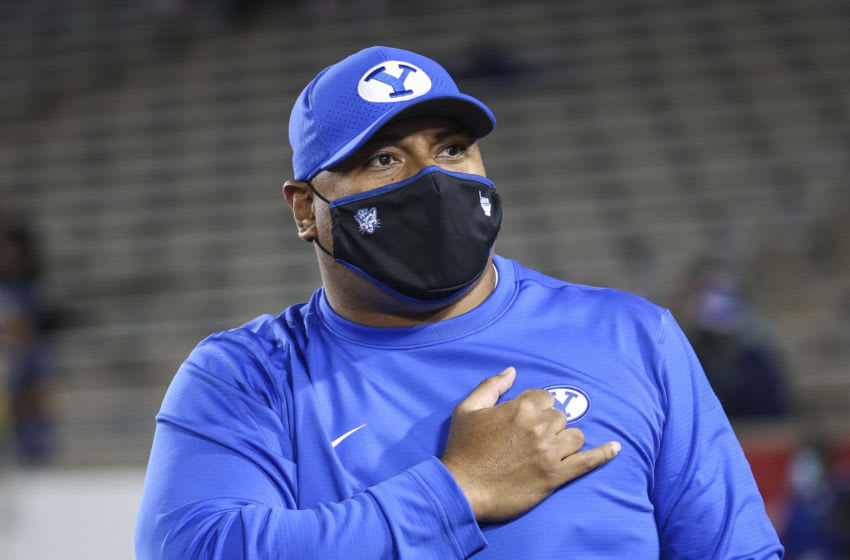 Oct 16, 2020; Houston, Texas, USA; Brigham Young Cougars head coach Kalani Sitake walks onto the field before a game against the Houston Cougars at TDECU Stadium. Mandatory Credit: Troy Taormina-USA TODAY Sports