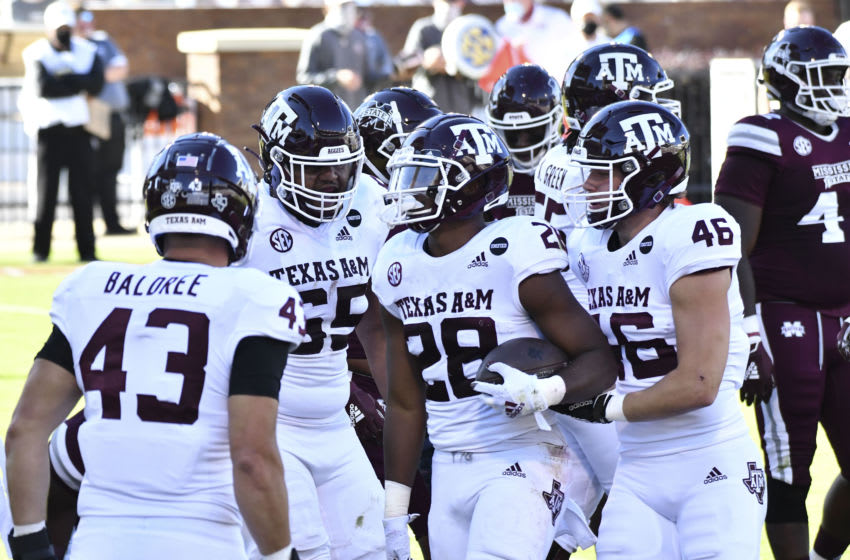 Oct 17, 2020; Starkville, Mississippi, USA; Texas A&M Aggies running back Isaiah Spiller (28) reacts with teammates after a touchdown against the Mississippi State Bulldogs during the second quarter at Davis Wade Stadium at Scott Field. Mandatory Credit: Matt Bush-USA TODAY Sports
