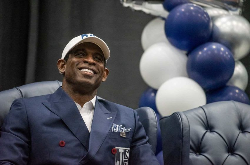 Deion Sanders listens as Jackson State University Athletic Director Ashley Robinson speaks during the announcement of Sanders as head coach for the university's football team during a ceremony at JSU on Monday, September 21, 2020.