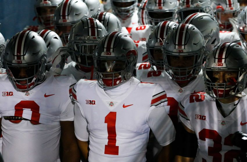 Ohio State Buckeyes quarterback Justin Fields (1) prepares to lead the Buckeyes onto the field before a NCAA football game at Beaver Stadium in University Park, Pa. on Saturday, Oct. 31, 2020. Ohio State Faces Penn State In Happy Valley