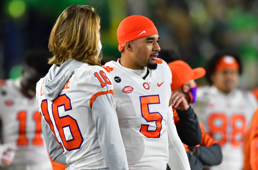 Nov 7, 2020; South Bend, Indiana, USA; Clemson Tigers quarterback Trevor Lawrence (16) talks to Tigers quarterback D.J. Uiagalelei (5) in the first quarter against the Notre Dame Fighting Irish at Notre Dame Stadium. Notre Dame defeated Clemson 47-40 in two overtimes. Mandatory Credit: Matt Cashore-USA TODAY Sports