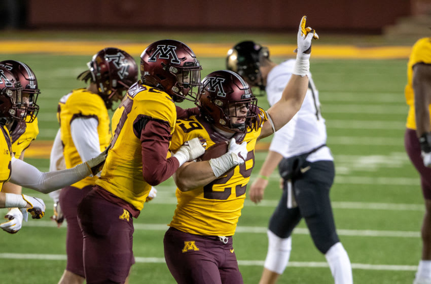 Nov 20, 2020; Minneapolis, Minnesota, USA; Minnesota Golden Gophers linebacker Josh Aune (29) celebrates with defensive back Tyler Nubin (27) after intercepting a pass in the fourth quarter against the Purdue Boilermakers at TCF Bank Stadium. Mandatory Credit: Jesse Johnson-USA TODAY Sports