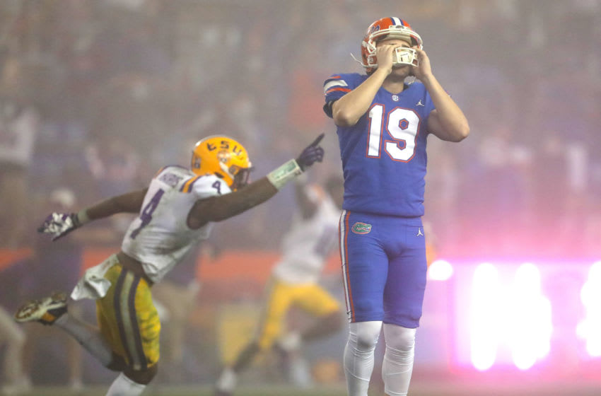 Dec 12, 2020; Gainesville, FL, USA; Florida Gators kicker Evan McPherson (19) hold his helmet in dejection after missing a last second field goal that would have tied the game during a game against the LSU Tigers at Ben Hill Griffin Stadium in Gainesville, Fla. Dec. 12, 2020. Florida lost 37-34 to the Tigers. Mandatory Credit: Brad McClenny-USA TODAY NETWORK