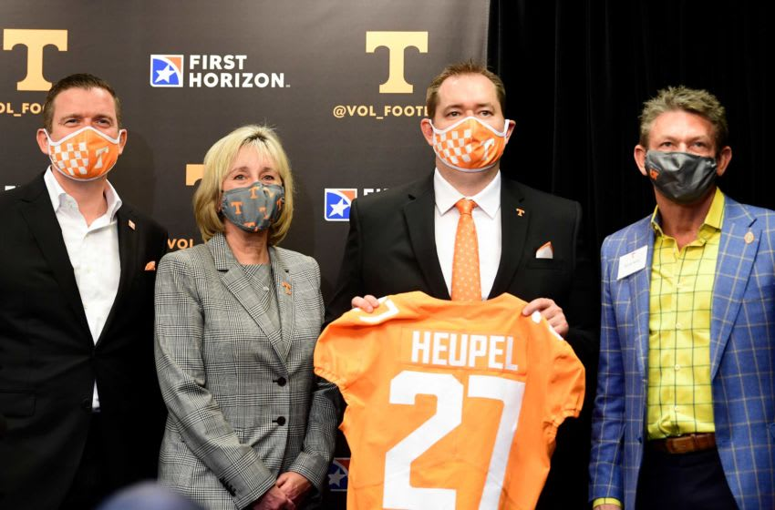 From left University of Tennessee athletic director Danny White, UT chancellor Donde Plowman, University of Tennessee head football coach Josh Heupel, and president of the UT System Randy Boyd, pose for a photo after a press conference announcing Heupel as football head coach, in the Stokely Family Media Center in Neyland Stadium, in Knoxville, Tenn., Wednesday, Jan.27, 2021. Heupel0127 0300
