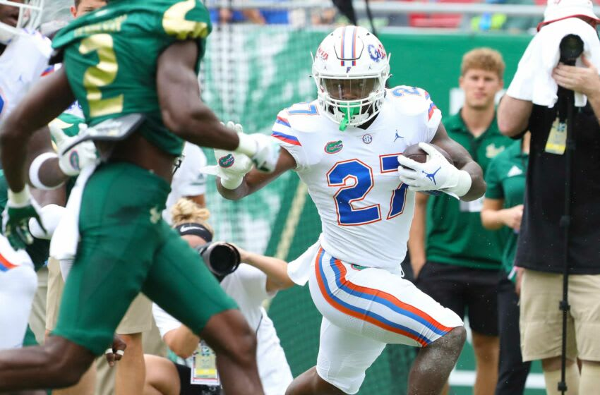 Florida Gators running back Dameon Pierce (27) stiff arms a defender as he runs the ball up the sideline during the second game of the season against the USF Bulls at Raymond James Stadium, in Tampa Fla. Sept. 11, 2021. Flgai 09112021 Ufvs Usf Action29