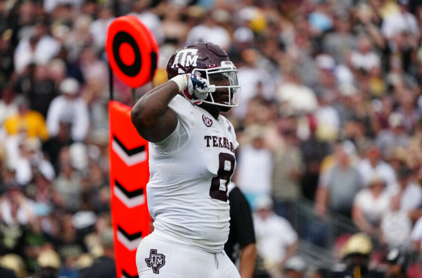 Sep 11, 2021; Denver, Colorado, USA; Texas A&M Aggies defensive lineman DeMarvin Leal (8) celebrates a stop in the second quarter against the Colorado Buffaloes at Empower Field at Mile High. Mandatory Credit: Ron Chenoy-USA TODAY Sports