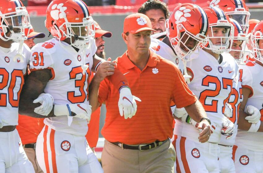 Clemson head coach Dabo Swinney joins players for the Walk of Champions before the game with NC State University at Carter-Finley Stadium in Raleigh, N.C., Saturday, September 25, 2021. Ncaa Football Clemson At Nc State