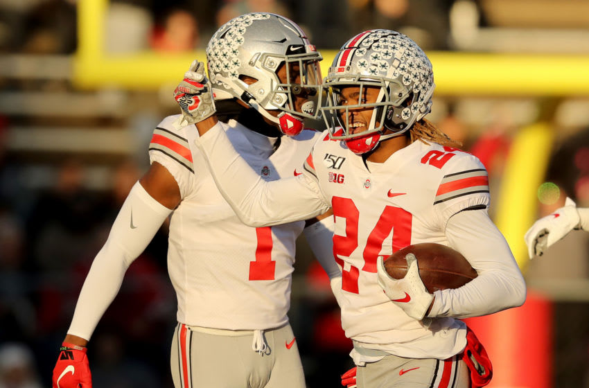 PISCATAWAY, NEW JERSEY - NOVEMBER 16: Shaun Wade #24 of the Ohio State Buckeyes celebrates his interception with teammate Jeff Okudah #1 in the first quarter against the Rutgers Scarlet Knights at SHI Stadium on November 16, 2019 in Piscataway, New Jersey. (Photo by Elsa/Getty Images)