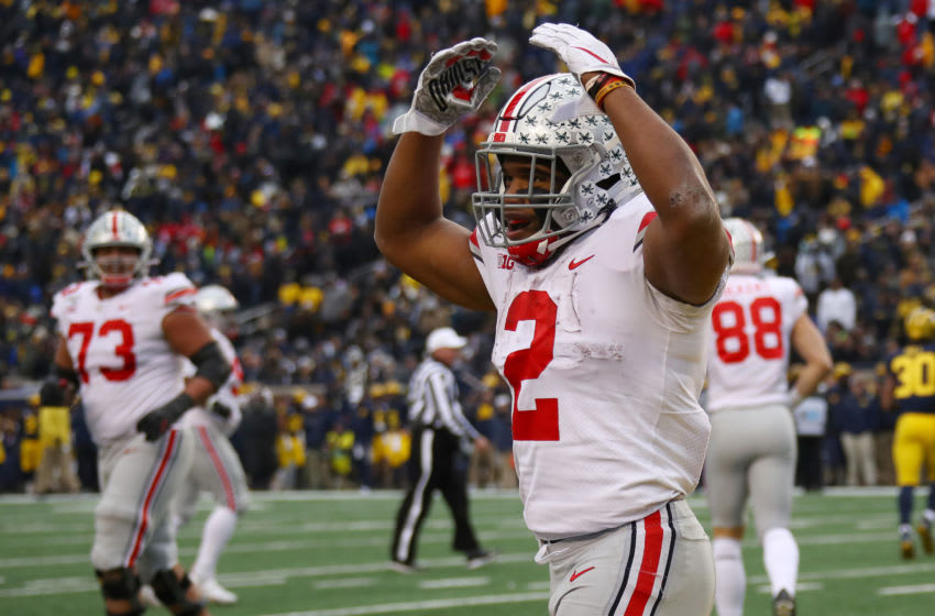 ANN ARBOR, MICHIGAN - NOVEMBER 30: J.K. Dobbins #2 of the Ohio State Buckeyes celebrates his fourth quarter touchdown while playing the Michigan Wolverines at Michigan Stadium on November 30, 2019 in Ann Arbor, Michigan. (Photo by Gregory Shamus/Getty Images)