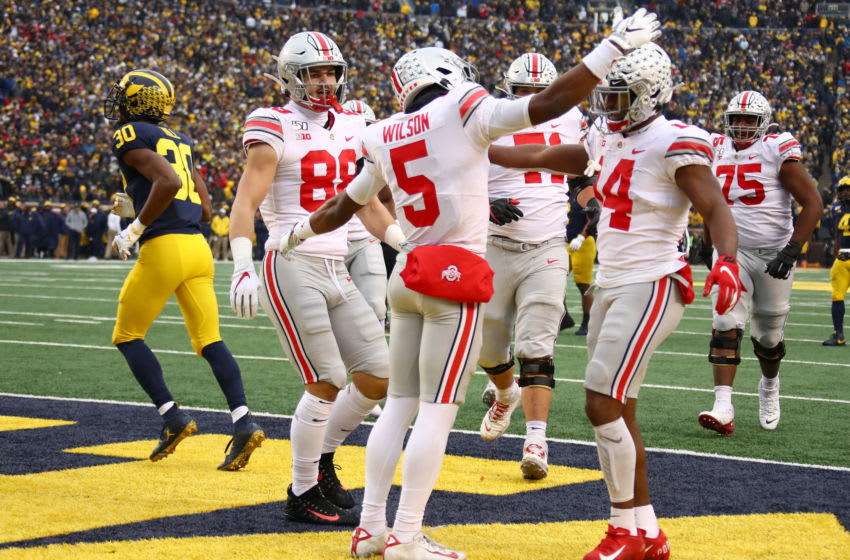 ANN ARBOR, MICHIGAN - NOVEMBER 30: Garrett Wilson #5 of the Ohio State Buckeyes celebrates his second half touchdown against the Michigan Wolverines at Michigan Stadium on November 30, 2019 in Ann Arbor, Michigan. Ohio State won the game 56-27. (Photo by Gregory Shamus/Getty Images)