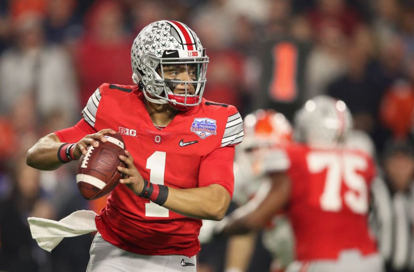 GLENDALE, ARIZONA - DECEMBER 28: Quarterback Justin Fields #1 of the Ohio State Buckeyes drop back to pass during the PlayStation Fiesta Bowl against the Clemson Tigers at State Farm Stadium on December 28, 2019 in Glendale, Arizona. The Tigers defeated the Buckeyes 29-23. (Photo by Christian Petersen/Getty Images)