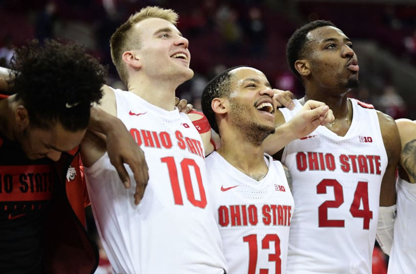 COLUMBUS, OHIO - FEBRUARY 01: Justin Ahrens #10, CJ Walker #13 and Andre Wesson #24 of the Ohio State Buckeyes celebrate their 68-59 win over the Indiana Hoosiers at Value City Arena on February 01, 2020 in Columbus, Ohio. (Photo by Emilee Chinn/Getty Images)