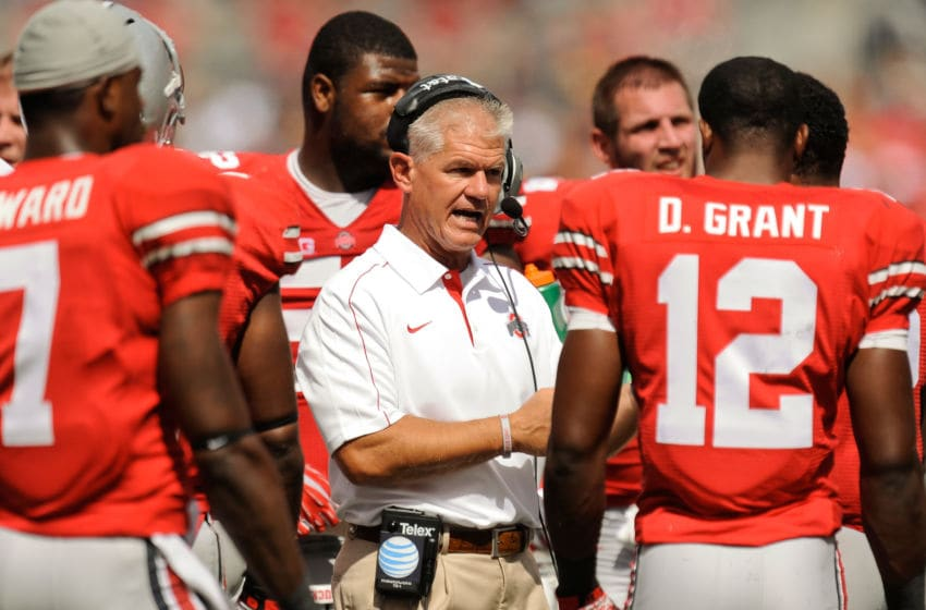COLUMBUS, OH - SEPTEMBER 15: Cornerbacks Coach Kerry Coombs of the Ohio State Buckeyes huddles with his players during a game against the California Golden Bears at Ohio Stadium on September 15, 2012 in Columbus, Ohio. (Photo by Jamie Sabau/Getty Images)