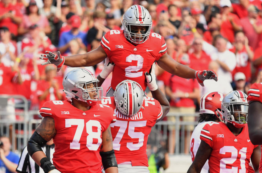 COLUMBUS, OH - OCTOBER 6: J.K. Dobbins #2 of the Ohio State Buckeyes celebrates his first quarter touchdown run against the Indiana Hoosiers with Thayer Munford #75 of the Ohio State Buckeyes at Ohio Stadium on October 6, 2018 in Columbus, Ohio. (Photo by Jamie Sabau/Getty Images)