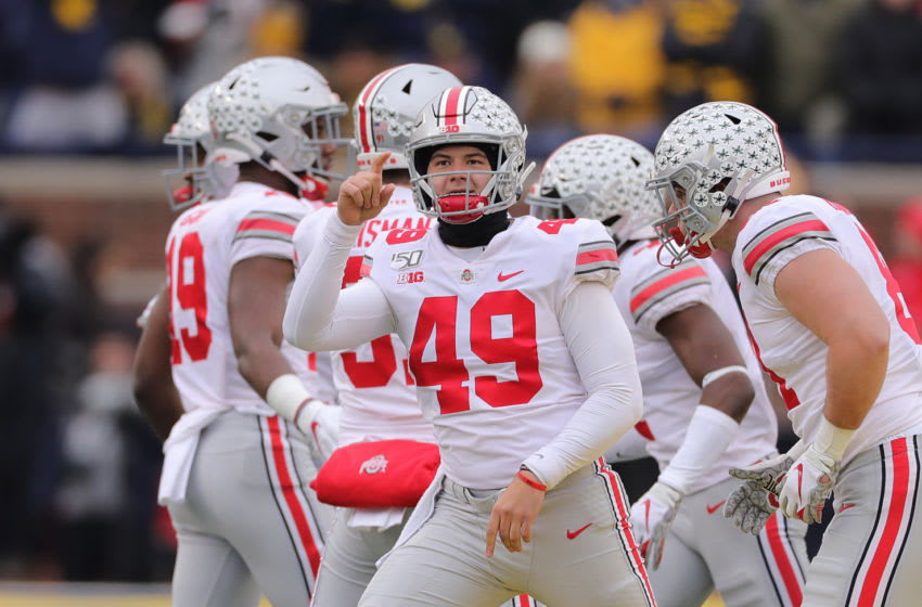 ANN ARBOR, MI - NOVEMBER 30: Liam McCullough #49 of the Ohio State Buckeyes reacts to a fourth down stop during the fourth quarter of the game against the Michigan Wolverines at Michigan Stadium on November 30, 2019 in Ann Arbor, Michigan. Ohio State defeated Michigan 56-27. (Photo by Leon Halip/Getty Images)