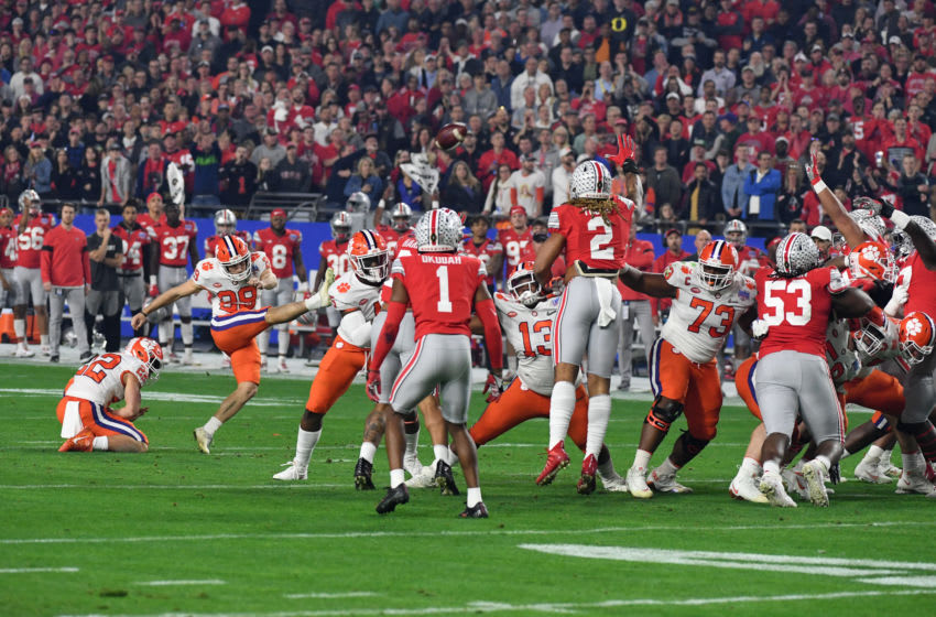 GLENDALE, ARIZONA - DECEMBER 28: BT Potter #29 of the Clemson Tigers attempts a field goal against the Ohio State Buckeyes during the Playstation Fiesta Bowl at State Farm Stadium on December 28, 2019 in Glendale, Arizona. (Photo by Norm Hall/Getty Images)