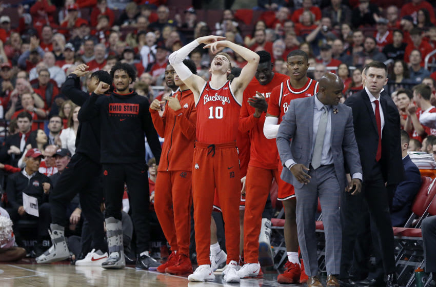COLUMBUS, OHIO - MARCH 01: Justin Ahrens #10 of the Ohio State Buckeyes celebrates a traveling call on the sidelines in the game against the Michigan Wolverines during the second half at Value City Arena on March 01, 2020 in Columbus, Ohio. (Photo by Justin Casterline/Getty Images)