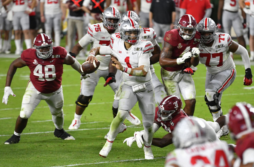 MIAMI GARDENS, FLORIDA - JANUARY 11: Justin Fields #1 of the Ohio State Buckeyes moves in the pocket during the College Football Playoff National Championship football game against the Alabama Crimson Tide at Hard Rock Stadium on January 11, 2021 in Miami Gardens, Florida. The Alabama Crimson Tide defeated the Ohio State Buckeyes 52-24. (Photo by Alika Jenner/Getty Images)